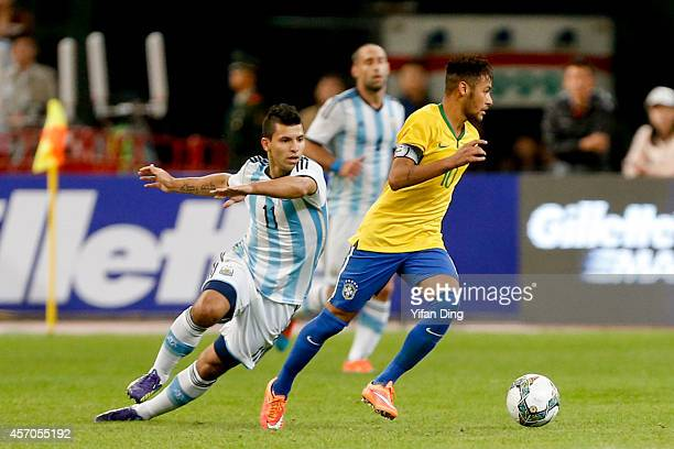 Sergio Aguero of Argentina and Neymar of Brazil battle for the ball during a match between Argentina and Brazil as part of 2014 Superclasico de las...
