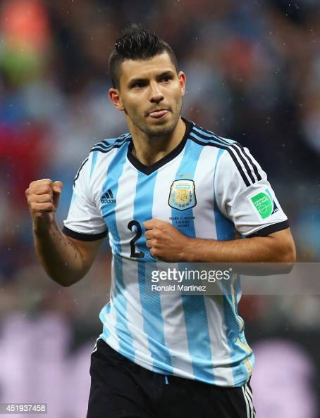 Sergio Aguero of Argentina celebrates scoring his penalty kick in a shootout during the 2014 FIFA World Cup Brazil Semi Final match between the...