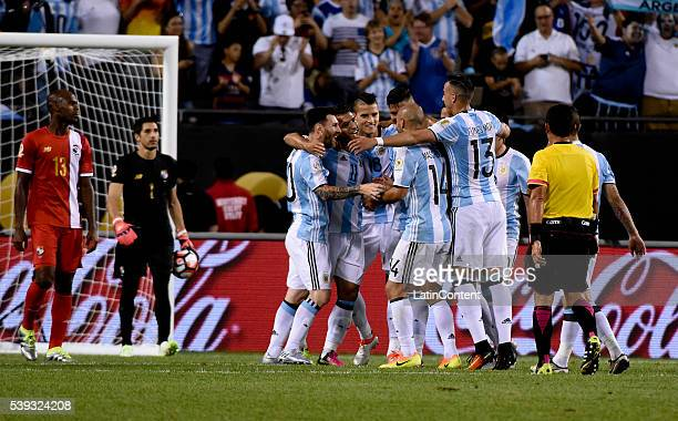 Sergio Aguero of Argentina celebrates with teammates after scoring the fourth goal of his team during a group D match between Argentina and Panama at...
