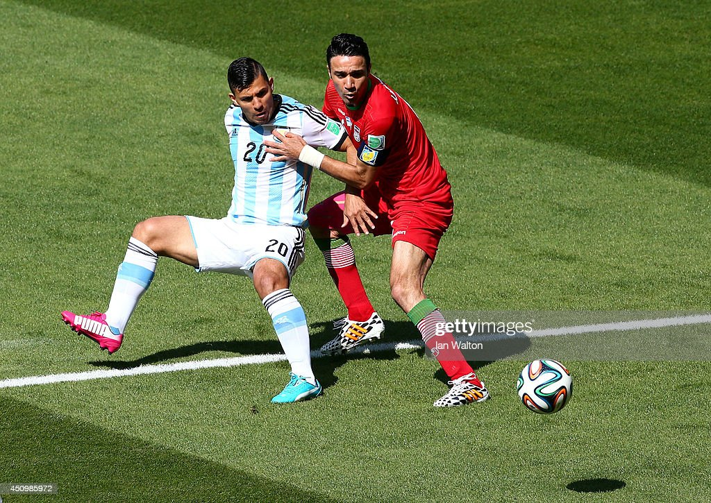 Sergio Aguero of Argentina competes for the ball with <a gi-track='captionPersonalityLinkClicked' href=/galleries/search?phrase=Javad+Nekounam&family=editorial&specificpeople=555005 ng-click='$event.stopPropagation()'>Javad Nekounam</a> of Iran during the 2014 FIFA World Cup Brazil Group F match between Argentina and Iran at Estadio Mineirao on June 21, 2014 in Belo Horizonte, Brazil.