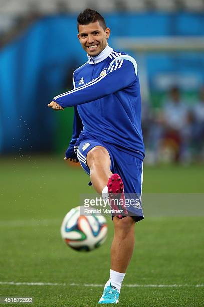 Sergio Aguero of Argentina dribbles the ball during a training session at Arena de Sao Paulo on July 8 2014 in Sao Paulo Brazil