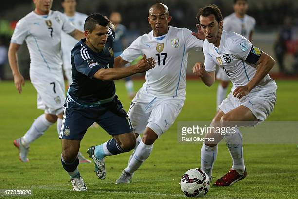 Sergio Aguero of Argentina fights for the ball with Diego Godin of Uruguay during the 2015 Copa America Chile Group B match between Argentina and...