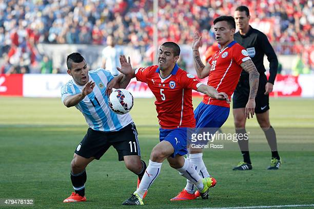 Sergio Aguero of Argentina fights for the ball with Francisco Silva of Chile during the 2015 Copa America Chile Final match between Chile and...