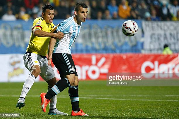 Sergio Aguero of Argentina fights for the ball with Jeison Murillo of Colombia during the 2015 Copa America Chile quarter final match between...