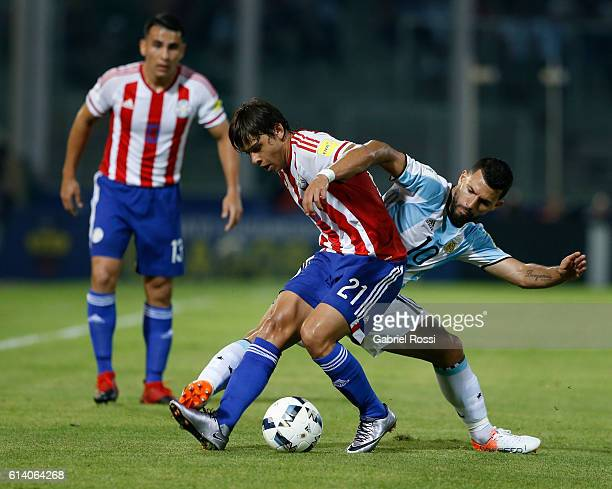 Sergio Aguero of Argentina fights for the ball with Oscar Romero of Paraguay during a match between Argentina and Paraguay as part of FIFA 2018 World...