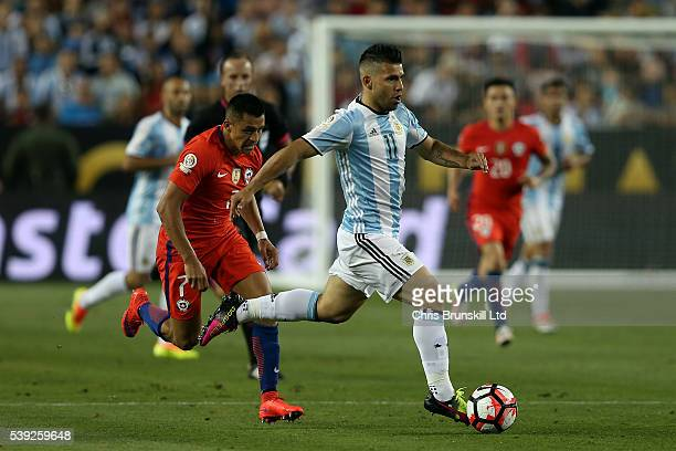 Sergio Aguero of Argentina in action with Alexis Sanchez of Chile during the Copa America Centenario Group D match between Argentina and Chile at...