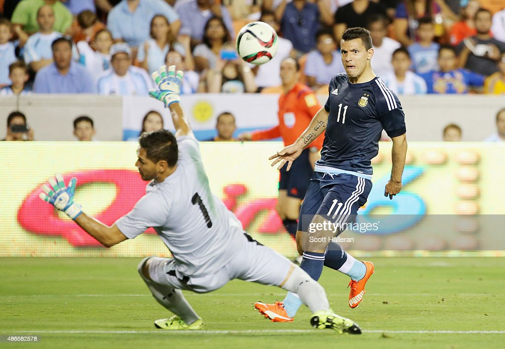 Sergio Aguero of Argentina scores a goal past Dainel Vaca of Bolivia during their international friendly match at BBVA Compass Stadium on September 4...
