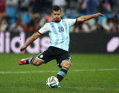 Sergio Aguero of Argentina shoots and scores his penalty kick in a shootout during the 2014 FIFA World Cup Brazil Semi Final match between the...