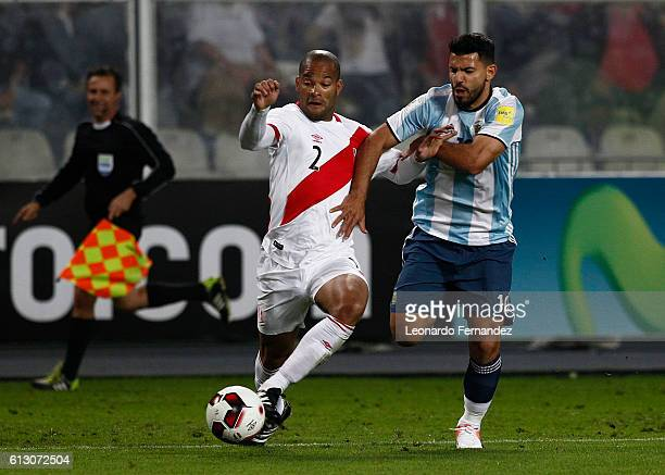Sergio Aguero of Argentina struggles for the ball with Alberto Rodriguez of Peru during a match between Peru and Argentina as part of FIFA 2018 World...