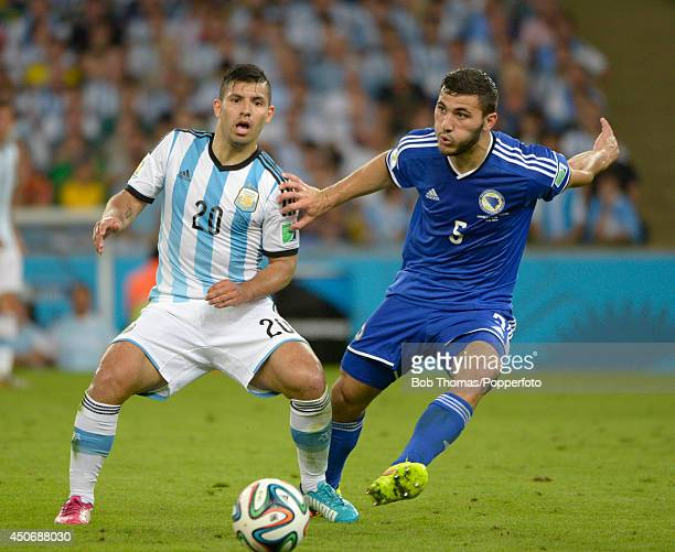 Sergio Aguero of Argentina with Sead Kolasinac of BosniaHerzegovina during the 2014 FIFA World Cup Brazil Group F match between Argentina and...