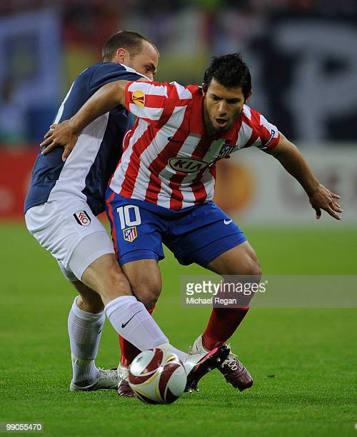 Sergio Aguero of Atletico Madrid is challenged by Danny Murphy of Fulham during the UEFA Europa League final match between Atletico Madrid and Fulham...