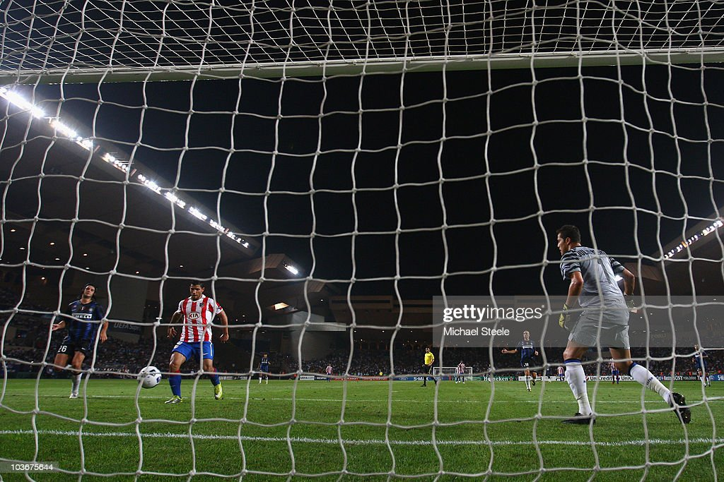Sergio Aguero (2nd l) of Atletico taps the ball in to score his sides second goal during the UEFA Super Cup match between Inter Milan and Atletico Madrid at Louis II Stadium on August 27, 2010 in Monaco, Monaco.