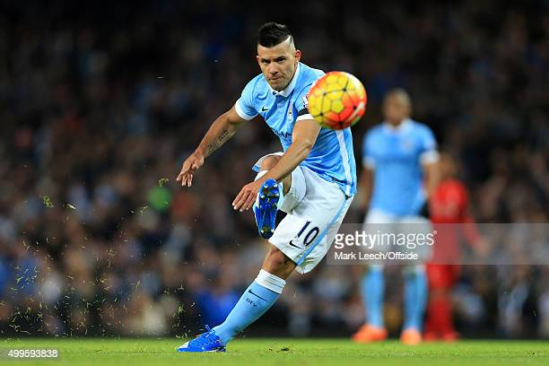 Sergio Aguero of Man City scores their 1st goal during the Barclays Premier League match between Manchester City and Liverpool at the Etihad Stadium...