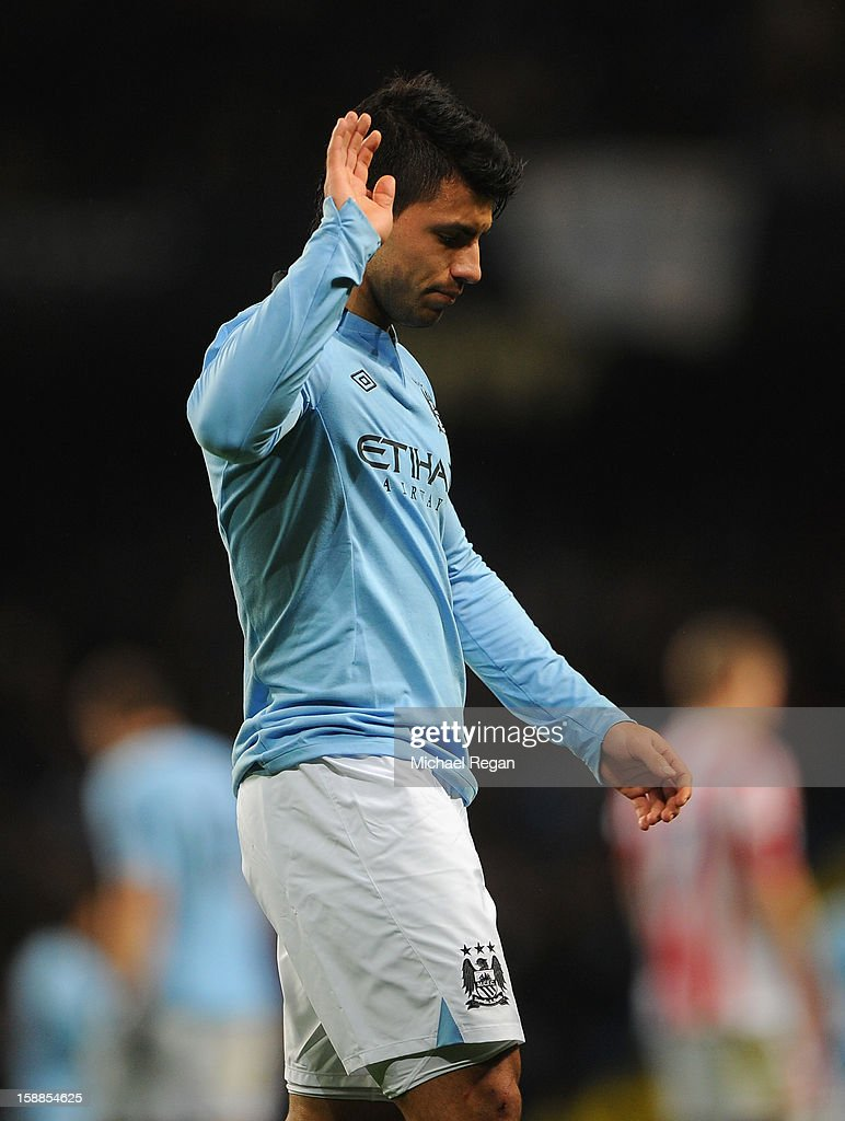 Sergio Aguero of Manchester City acknowledges the crowd as he is substituted during the Barclays Premier League match between Manchester City and Stoke City at the Etihad Stadium on January 1, 2013 in Manchester, England.