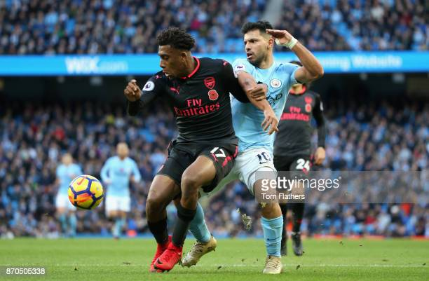 Sergio Aguero of Manchester City and Alex Iwobi of Arsenal battle for possession during the Premier League match between Manchester City and Arsenal...