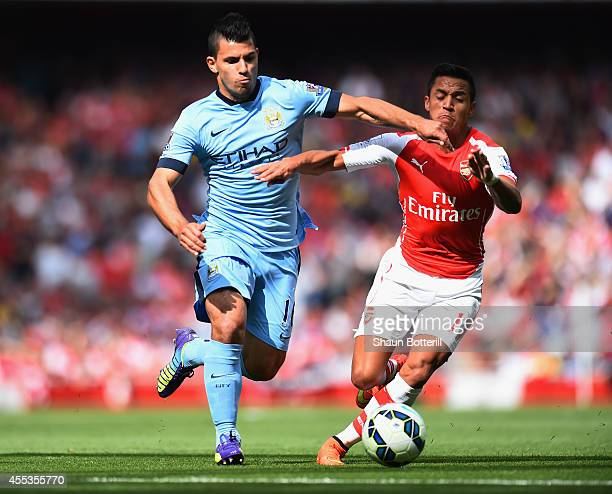 Sergio Aguero of Manchester City and Alexis Sanchez of Arsenal battle for the ball during the Barclays Premier League match between Arsenal and...