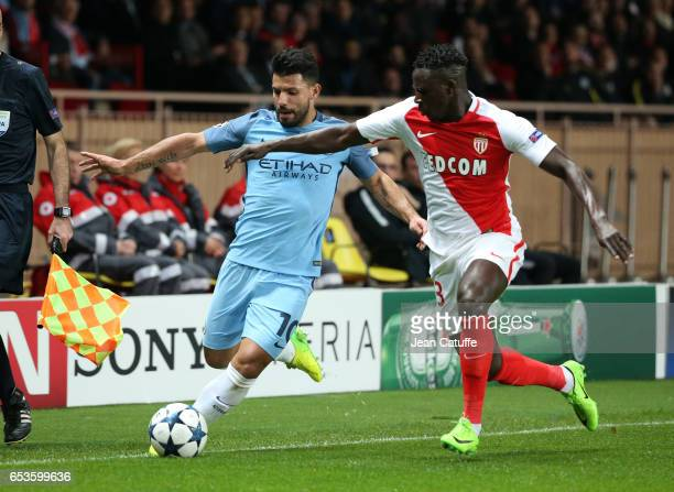 Sergio Aguero of Manchester City and Benjamin Mendy of Monaco in action during the UEFA Champions League Round of 16 second leg match between AS...