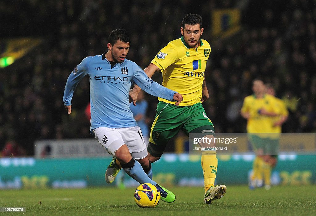 Sergio Aguero of Manchester City and Bradley Johnson of Norwich City battle for the ball during the Barclays Premier League match between Norwich City and Manchester City at Carrow Road on December 29, 2012 in Norwich, England.