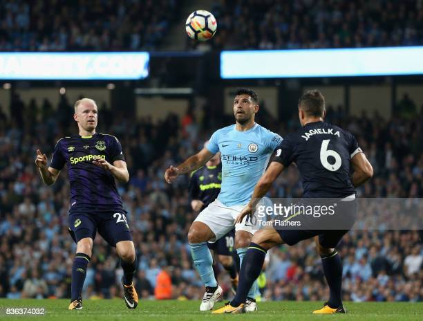 Sergio Aguero of Manchester City and Davy Klaassen of Everton have their eyes on the ball during the Premier League match between Manchester City and...