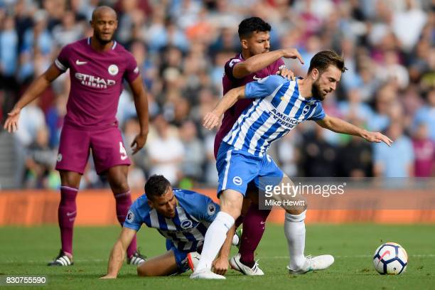 Sergio Aguero of Manchester City and Davy Propper of Brighton and Hove Albion battle for possession during the Premier League match between Brighton...