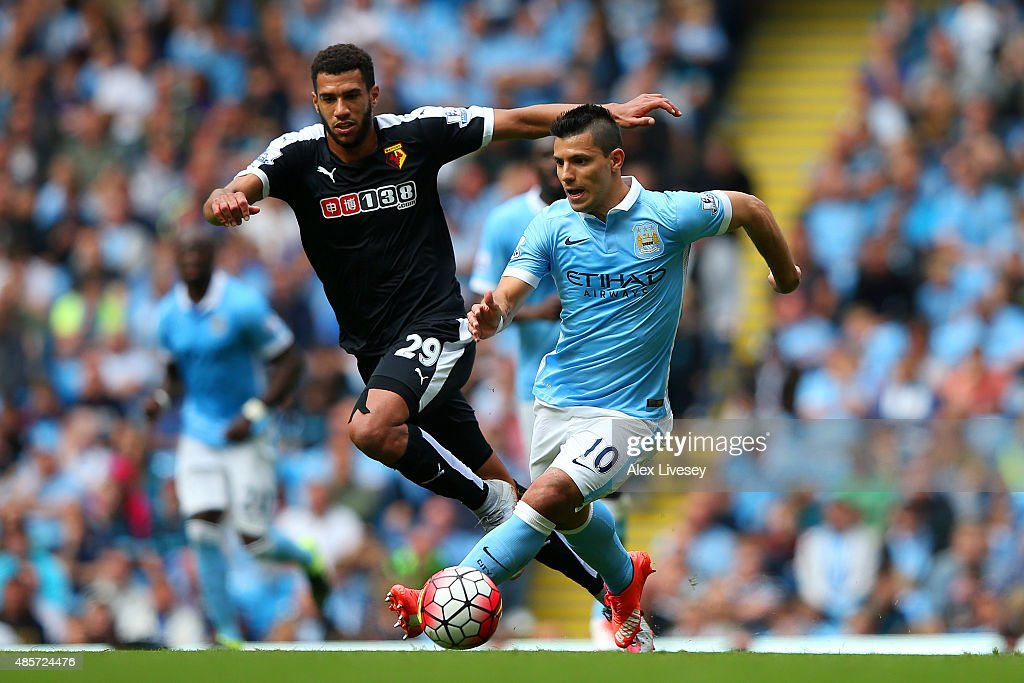Sergio Aguero of Manchester City and Etienne Capoue of Watford compete for the ball during the Barclays Premier League match between Manchester City and Watford at Etihad Stadium on August 29, 2015 in Manchester, England.