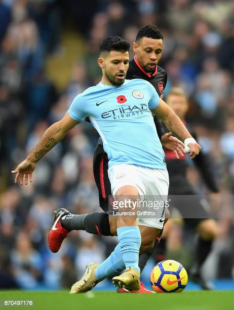 Sergio Aguero of Manchester City and Francis Coquelin of Arsneal battle for possession during the Premier League match between Manchester City and...