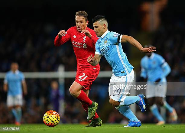 Sergio Aguero of Manchester City and Lucas Leiva of Liverpool compete for the ball during the Barclays Premier League match between Manchester City...