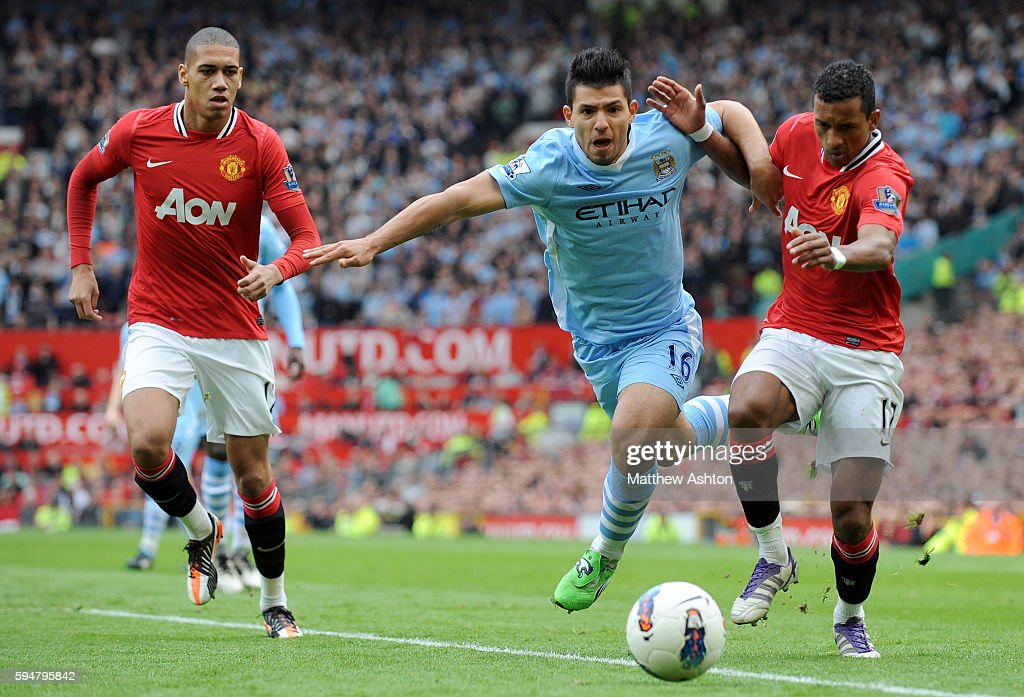 Sergio Aguero of Manchester City and Nani of Manchester United