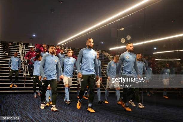 Sergio Aguero of Manchester City and Nicolas Otamendi of Manchester City walk out of the tunnel prior to the UEFA Champions League Group F match...
