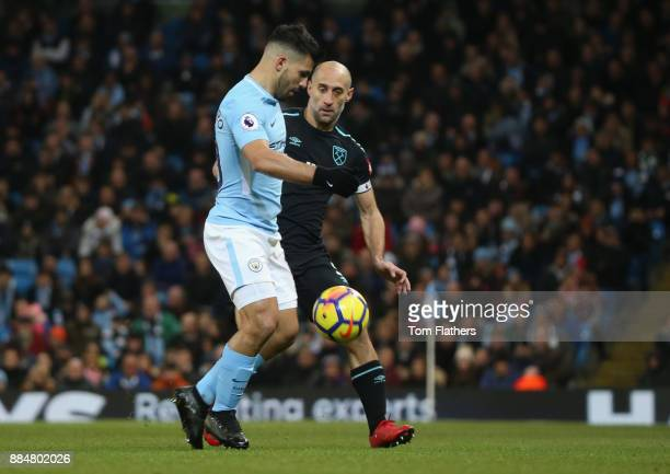 Sergio Aguero of Manchester City and Pablo Zabaleta of West Ham United battle for possession during the Premier League match between Manchester City...
