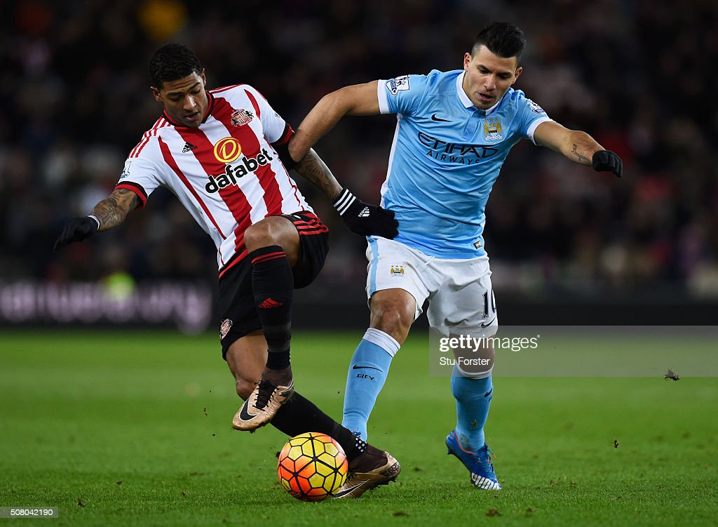 Sergio Aguero of Manchester City and Patrick van Aanholt of Sunderland compete for the ball during the Barclays Premier League match between...