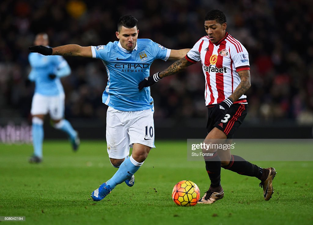 Sergio Aguero of Manchester City and Patrick van Aanholt of Sunderland compete for the ball during the Barclays Premier League match between Sunderland and Manchester City at the Stadium of Light on February 2, 2016 in Sunderland, England.