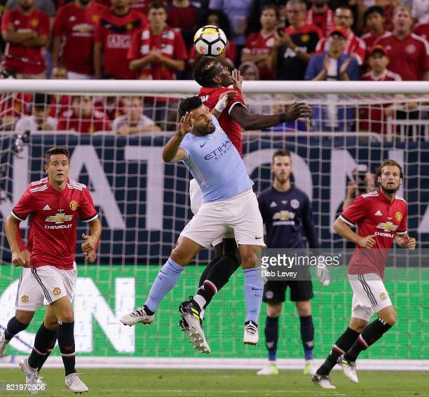 Sergio Aguero of Manchester City and Paul Pogba of Manchester United go up for a header at NRG Stadium on July 20 2017 in Houston Texas