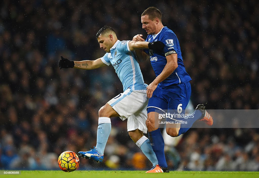 <a gi-track='captionPersonalityLinkClicked' href=/galleries/search?phrase=Sergio+Aguero&family=editorial&specificpeople=1100704 ng-click='$event.stopPropagation()'>Sergio Aguero</a> of Manchester City and <a gi-track='captionPersonalityLinkClicked' href=/galleries/search?phrase=Phil+Jagielka&family=editorial&specificpeople=682518 ng-click='$event.stopPropagation()'>Phil Jagielka</a> of Everton compete for the ball during the Barclays Premier League match between Manchester City and Everton at the Etihad Stadium on January 13, 2016 in Manchester, England.