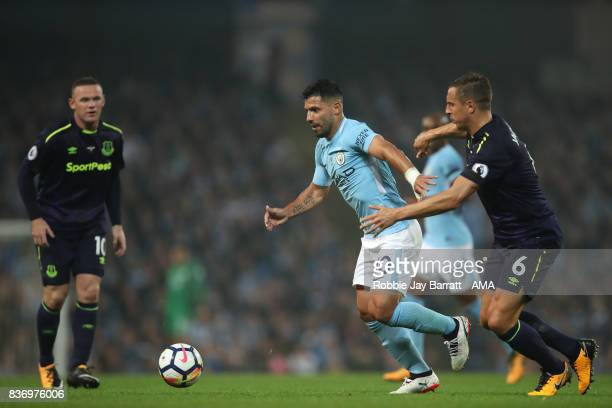 Sergio Aguero of Manchester City and Phil Jagielka of Everton during the Premier League match between Manchester City and Everton at Etihad Stadium...
