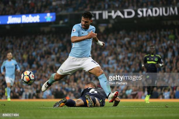 Sergio Aguero of Manchester City and Phil Jagielka of Everton in action during the Premier League match between Manchester City and Everton at Etihad...