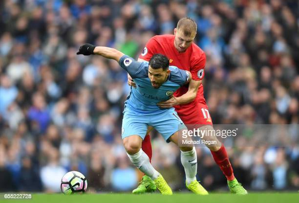Sergio Aguero of Manchester City and Ragnar Klavan of Liverpool battle for possession during the Premier League match between Manchester City and...
