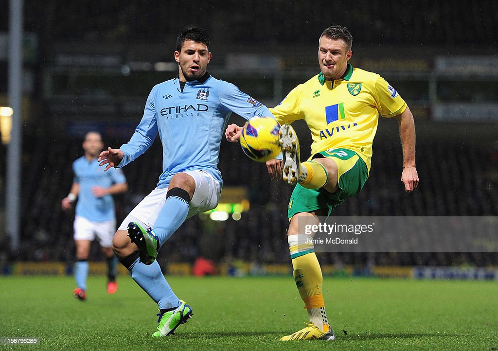 Sergio Aguero of Manchester City and Russell Martin of Norwich City battle for the ball during the Barclays Premier League match between Norwich City and Manchester City at Carrow Road on December 29, 2012 in Norwich, England.