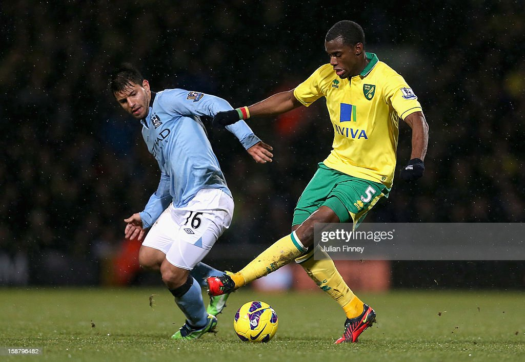 Sergio Aguero of Manchester City and Sebastien Bassong of Norwich City battle for the ball during the Barclays Premier League match between Norwich City and Manchester City at Carrow Road on December 29, 2012 in Norwich, England.