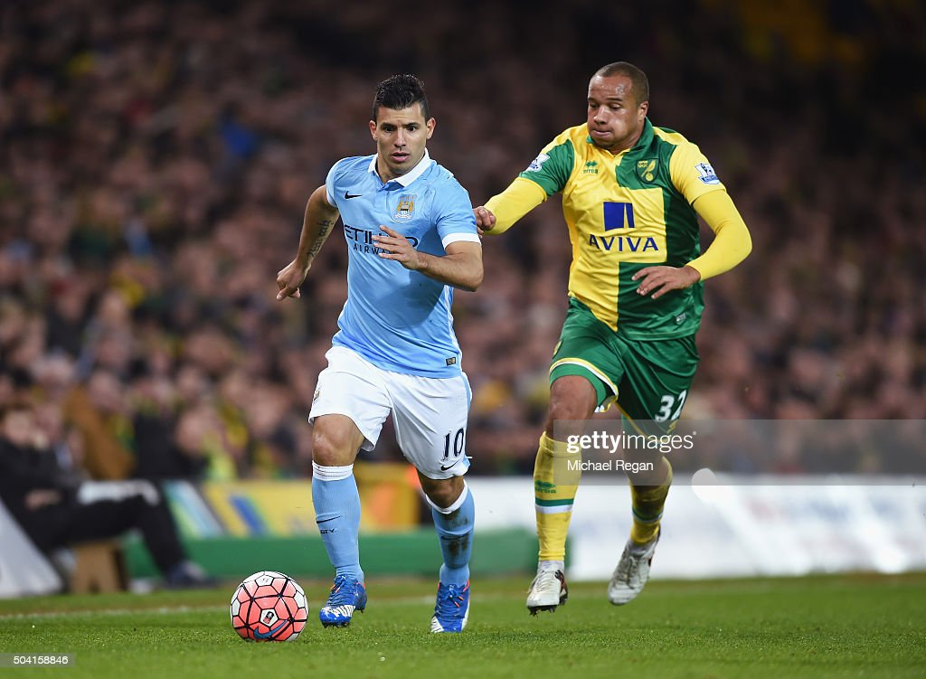 Sergio Aguero of Manchester City and Vadis Odjidja Ofoe of Norwich City compete for the ball during the Emirates FA Cup third round match between...