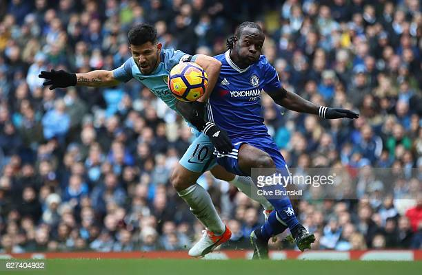 Sergio Aguero of Manchester City and Victor Moses of Chelsea compete for the ball during the Premier League match between Manchester City and Chelsea...