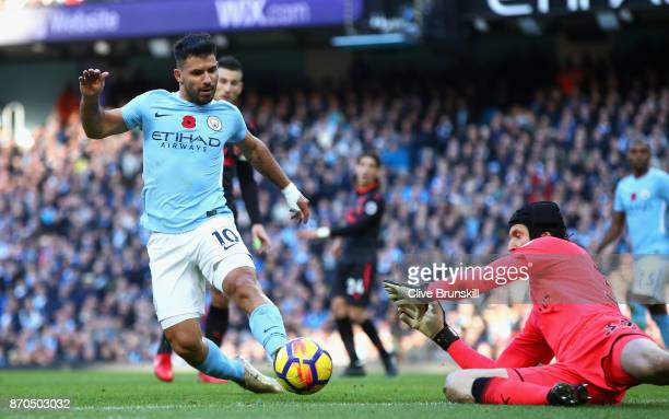 Sergio Aguero of Manchester City attempts to get past Petr Cech of Arsenal during the Premier League match between Manchester City and Arsenal at...