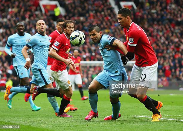 Sergio Aguero of Manchester City battle with Chris Smalling of Manchester United during the Barclays Premier League match between Manchester United...