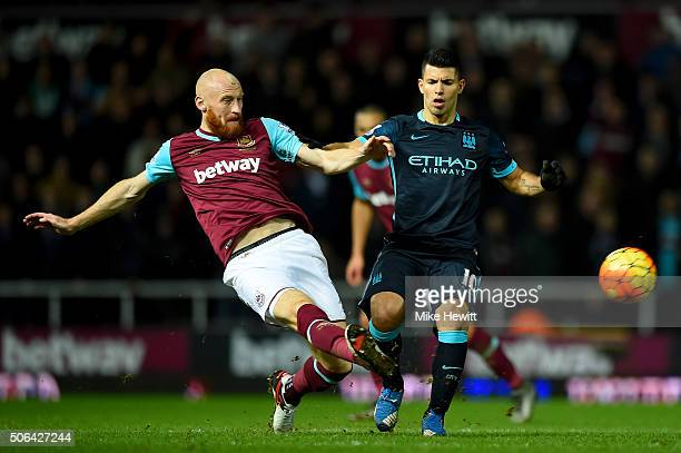 Sergio Aguero of Manchester City battles for the ball with James Collins of West Ham United during the Barclays Premier League match between West Ham...