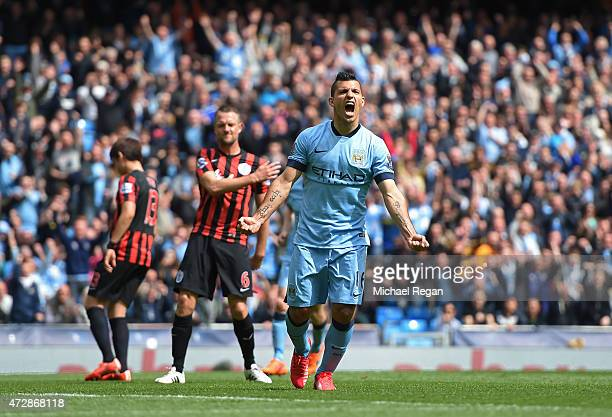 Sergio Aguero of Manchester City celebrates after scoring his team's fourth goal from the penalty spot during the Barclays Premier League match...