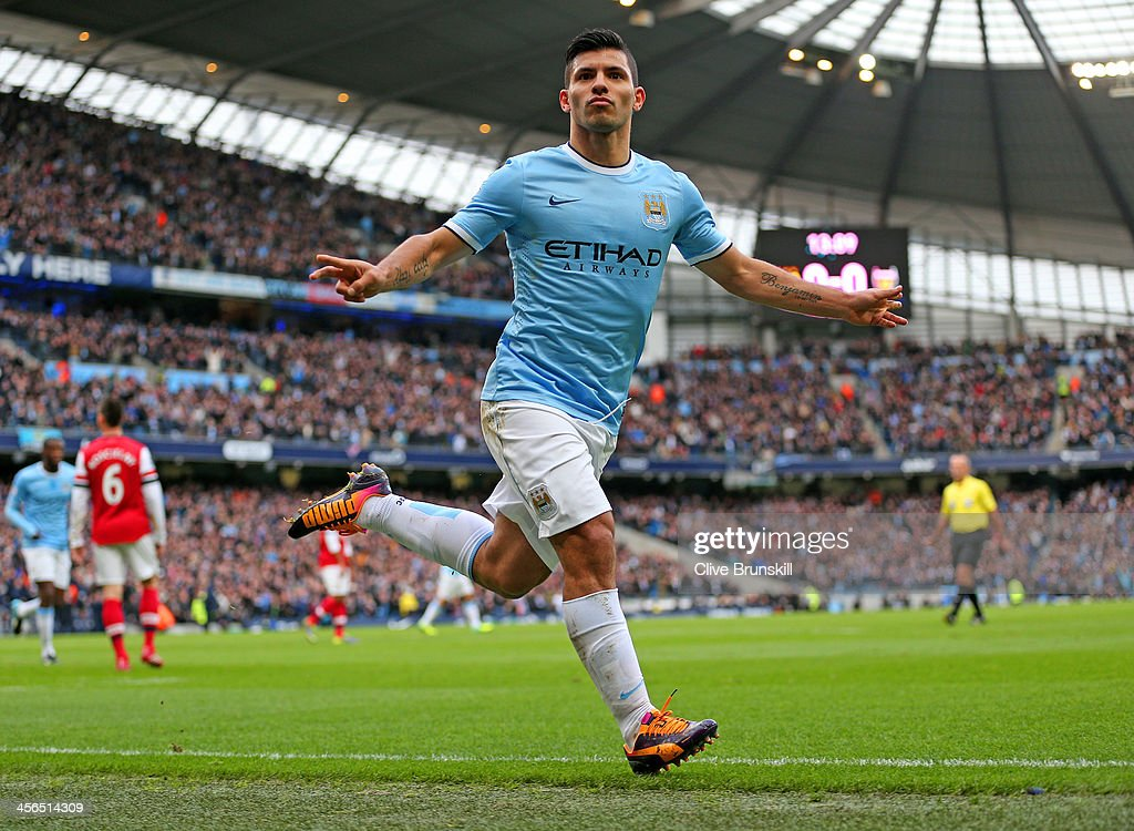 Sergio Aguero of Manchester City celebrates after scoring the opening goal during the Barclays Premier League match between Manchester City and...