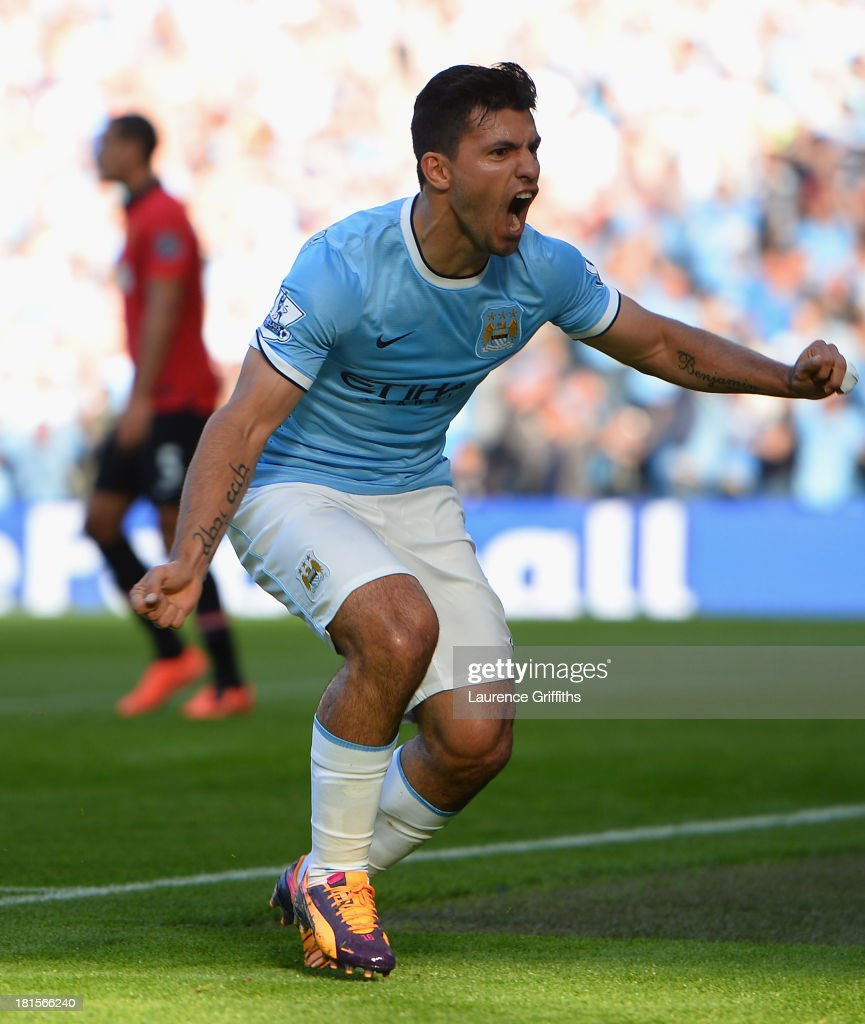 Sergio Aguero of Manchester City (16) celebrates as he scores their first goal during the Barclays Premier League match between Manchester City and Manchester United at the Etihad Stadium on September 22, 2013 in Manchester, England.