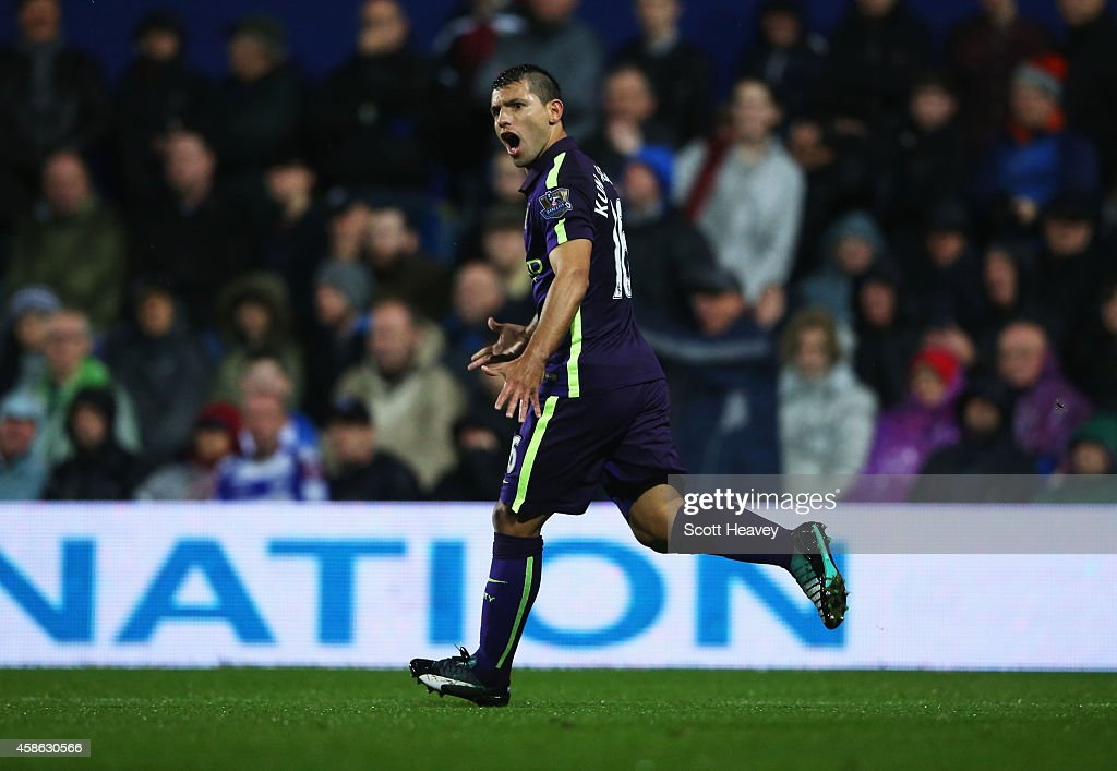 Sergio Aguero of Manchester City celebrates as he scores their first and equalising goal during the Barclays Premier League match between Queens Park...
