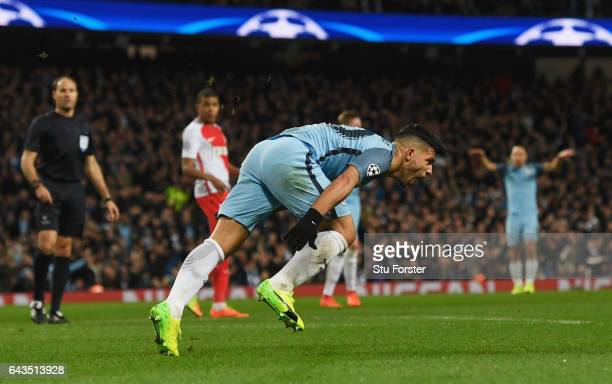 Sergio Aguero of Manchester City celebrates as he scores their third goal during the UEFA Champions League Round of 16 first leg match between...