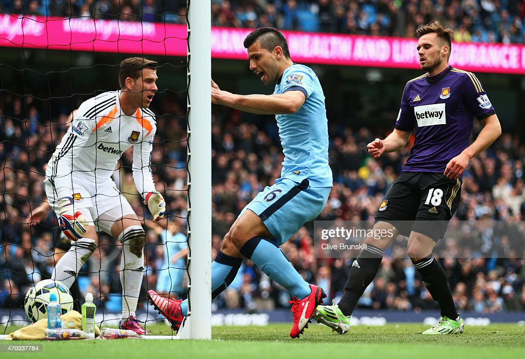 Sergio Aguero of Manchester City celebrates as James collins of West Ham (not pictured) scores an own goal during the Barclays Premier League match between Manchester City and West Ham United at Etihad Stadium on April 19, 2015 in Manchester, England.